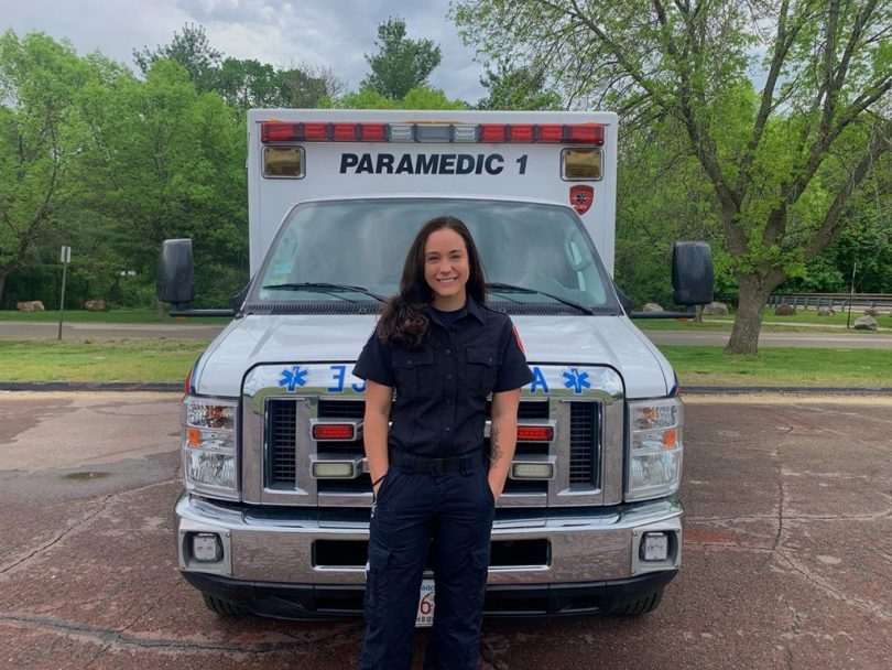 Kendyll Smith stands in front of an ambulance