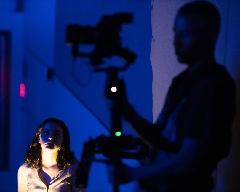 Film students work in front of the camera