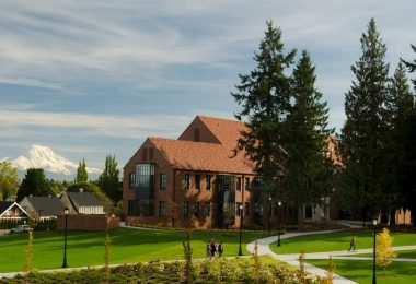 Mount Rainier is visible from many areas on campus. Here it's shown over Weyerhauser Hall, which is typical of Puget Sound's gothic architecture.