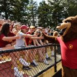 Students attend a sporting event with the Ursinus mascot