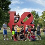 Students gather at the Love Statue on Ursinus College's campus