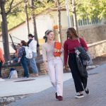 Two students walk together across the Goucher campus.