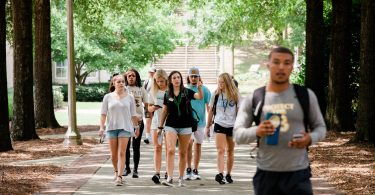students walking on a campus tour